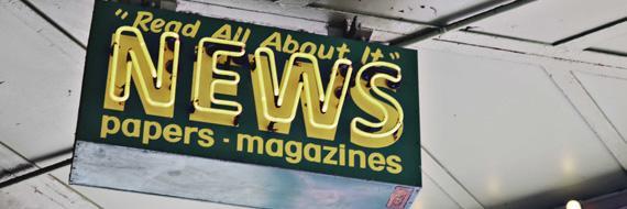 Uithangbord dat uitnodigt om nieuws te lezen